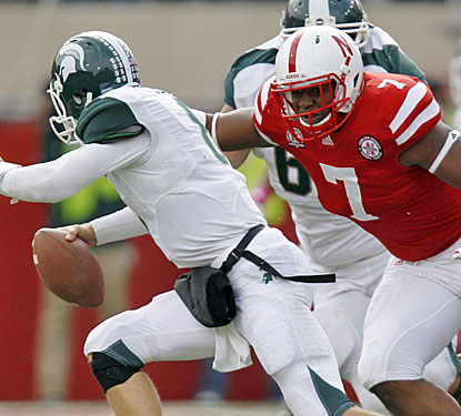 Nebraska's defense keeps Kirk Cousins on the run and holds Michigan State to 187 total yards.  (US Presswire)