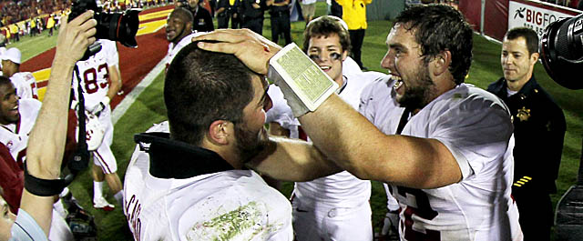 QB Andrew Luck (right) celebrates Stanford's hard-won victory over USC with his teammates. (Getty Images)