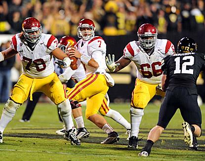 Matt Barkley (center) throws a school-record six touchdowns in No. 21 USC's 42-17 win over Colorado. (US Presswire)