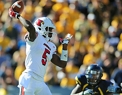 Louisville quarterback Teddy Bridgewater throws a TD pass as the Cardinals end a four-game skid against West Virginia. (US Presswire)
