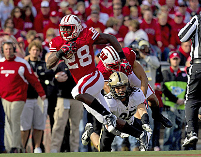 Wisconsin's Montee Ball rushes for a career-high 223 yards and three touchdowns in the Badgers' 62-17 rout of Purdue. (US Presswire)
