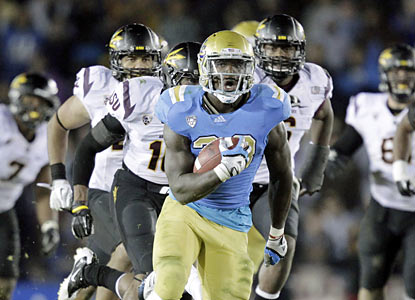 UCLA's Derrick Coleman rumbles for 119 yards and two TDs, including the winning score with less than a minute in regulation. (AP)