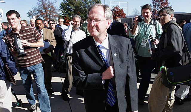 Penn State SID Jeff Nelson walks away from the media after saying Paterno wouldn't speak. (US Presswire)