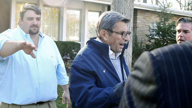Media members question Joe Paterno as he leaves his house Tuesday. (AP)