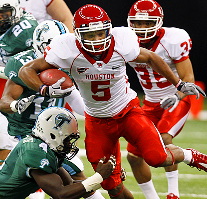 Houston's Charles Sims bowls over Tulane for a career-high 207 yards and two touchdowns.  (AP)