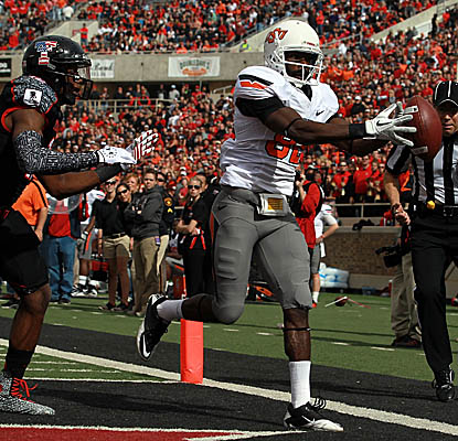 WR Isaiah Anderson pulls in the ball for one of Oklahoma State's five touchdown passes vs. Texas Tech. (Getty Images)