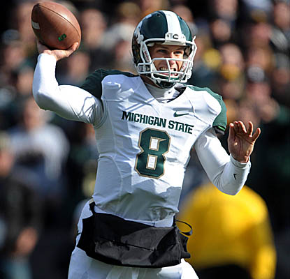 QB Kirk Cousins reaches 8,000 career passing yards at Iowa as the No. 13 Spartans roll. (Getty Images)