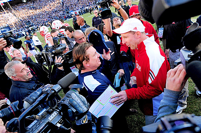 Penn State interim coach Tom Bradley shares a moment with Bo Pelini after the game. (US Presswire)