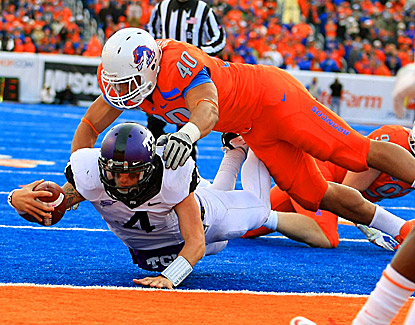 TCU quarterback Casey Pachall (4) runs in for the winning two-point conversion under Boise State's Tyrone Crawford. (US Presswire)