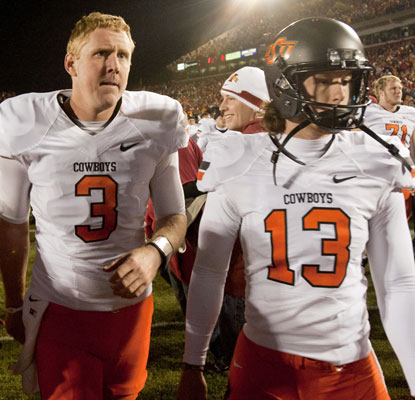 Quarterback Brandon Weeden (3) throws three interceptions and kicker Quinn Sharp misses a key kick in OSU's loss.  (US Presswire)