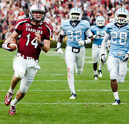 QB Connor Shaw rushes for a 60-yard touchdown to add to his three TD passes as South Carolina puts away Citadel. (US Presswire)