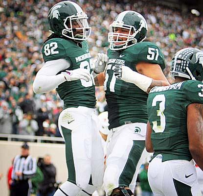 WR Keshawn Martin celebrates after scoring on a 19-yard TD pass as the No. 12 Spartans drub IU to clinch a Big Ten title bid. (US Presswire)