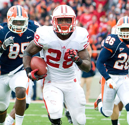 Montee Ball handles a heavy load for Wisconsin, turning 38 carries into 224 rushing yards and ups his 2011 TD total to 30.  (US Presswire)