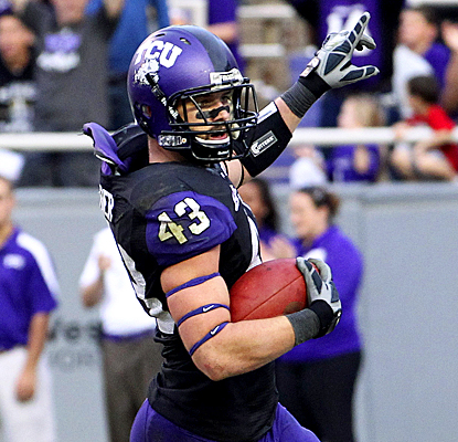 TCU's Tank Carder celebrates after running back an interception for a touchdown vs. Colorado State. (US Presswire)