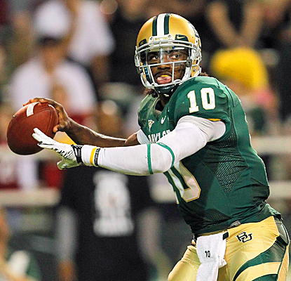 Baylor's Robert Griffin III completes 21 of 34 passes for 479 yards and four touchdowns. (Getty Images)
