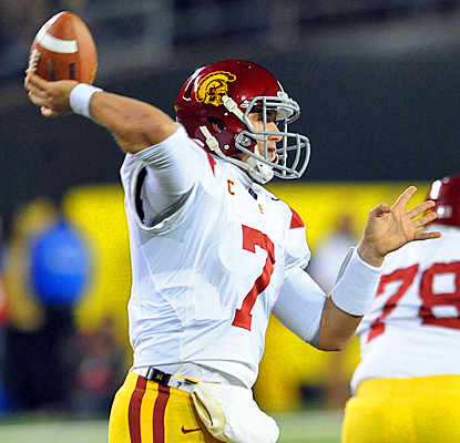 USC's Matt Barkley puts on a show against Oregon, completing 26 of 34 passes for 323 yards and four touchdowns. (Getty Images)