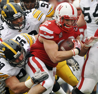 Days after shedding a walking boot, Rex Burkhead gains 160 yards and scores once on a school-record 38 carries.  (AP)