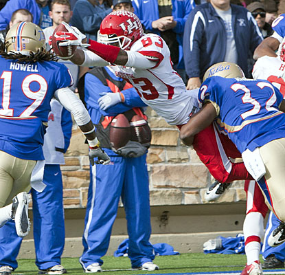 Houston's Patrick Edwards (eight receptions, 181 yards) dives for one of his four touchdowns.  (US Presswire)