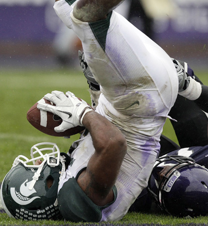 B.J. Cunningham catches a 29-yard TD pass in the second half.  The MSU wideout finishes with six receptions for 120 yards. (AP)