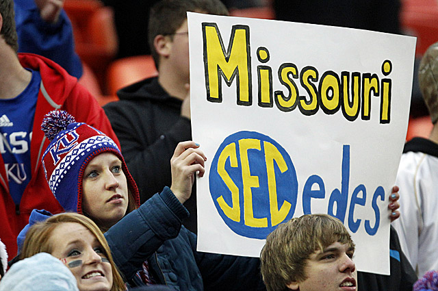 A Kansas fan holds up a sign about Missouri leaving the Big 12 conference for the SEC. (AP)