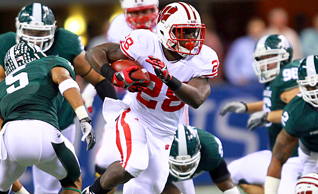 Montee Ball runs for 252 yards and four touchdowns this season against Michigan State. (US Presswire)