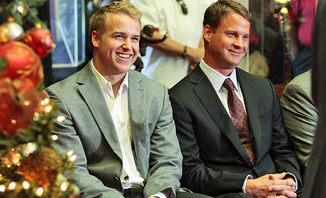 Matt Barkley (left) and Lane Kiffin are all smiles after Barkley's decision to stay at USC. (AP)