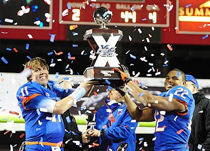 Kellen Moore (left) and game MVP Doug Martin (two touchdowns; 151 rushing yards) hoist the Las Vegas Bowl trophy.  (US Presswire)