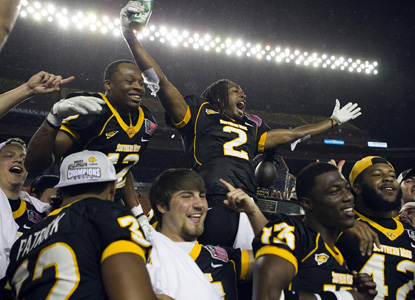 No. 22 Southern Miss celebrates its school-record 12th win for departing coach Larry Fedora in the Hawaii Bowl. (US Presswire)