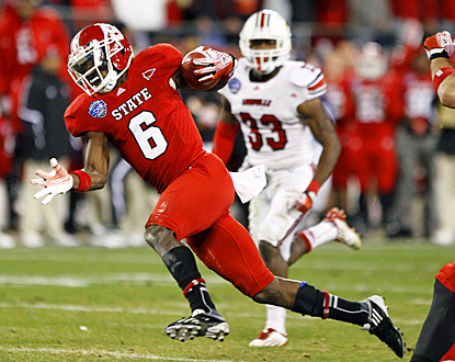 T.J. Graham breaks free against the Cardinals for two touchdown grabs for North Carolina State. (US Presswire)