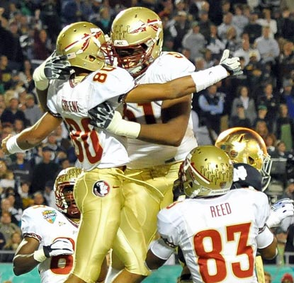 Florida State's Rashad Greene (80) celebrates his 18-yard touchdown and tallies 99 receiving yards on five catches.  (US Presswire)