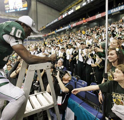 Robert Griffin III celebrates what might be his final game with Baylor fans after a thrilling Alamo Bowl.  (AP)