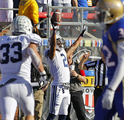 Cody Hoffman celebrates after his third TD catch, with 11 seconds left, gives BYU the go-ahead score.  (US Presswire)