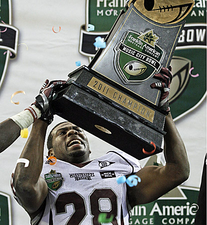 Vick Ballard holds the Music City Bowl trophy after running for two scores and 180 yards. (AP)