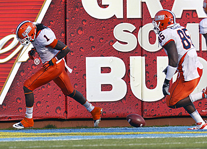 Illinois' Terry Hawthorne (left) scores after a 39-yard interception return in the third quarter against UCLA. (US Presswire)