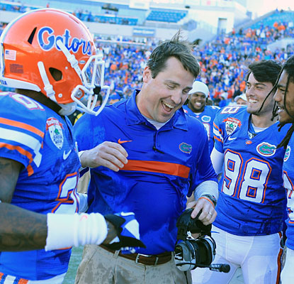First-year Florida coach Will Muschamp can enjoy the victory as the Gators avoid their first losing season since 1979.  (Getty Images)