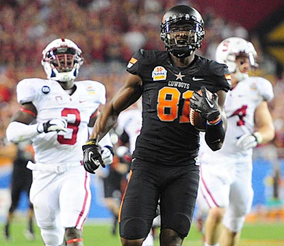 Despite a thigh ailment, Justin Blackmon notches touchdowns of 43 and 67 yards on his first two catches.  (US Presswire)