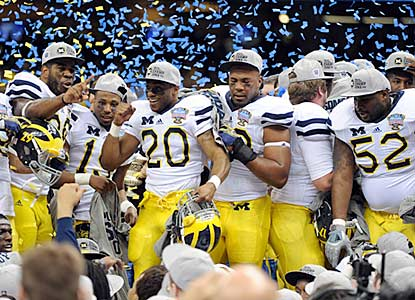 Michigan (11-2) celebrates its first victory in a BCS bowl game since the 2000 Orange Bowl.  (US Presswire)