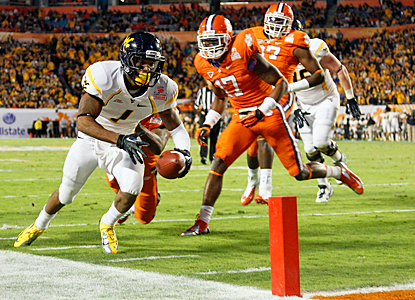 Tavon Austin dives for the end zone for a touchdown, one of four he scores against Clemson. (Getty Images)