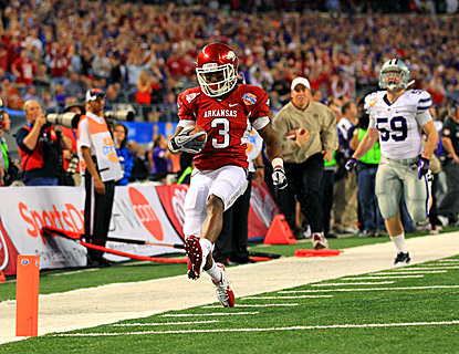 Arkansas' Joe Adams scores on a 51-yard punt return during the second quarter against Kansas State. (US Presswire)