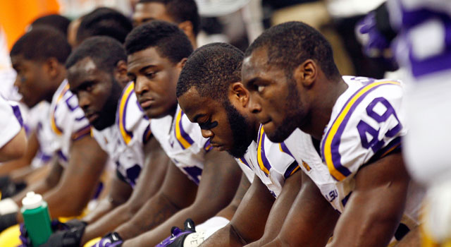 Some LSU players, along with fans and media, are not happy with their coach. (Getty Images)