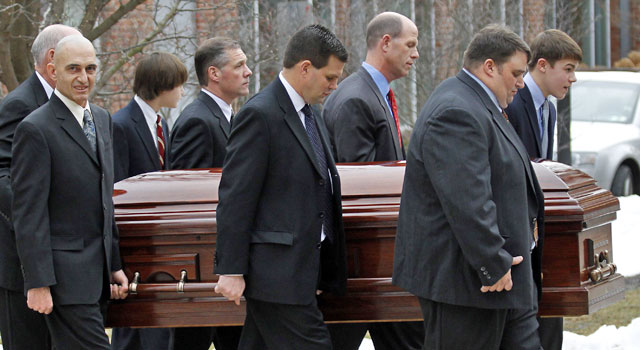 Joe Paterno's casket is carried out by pall bearers after a funeral service. (AP)