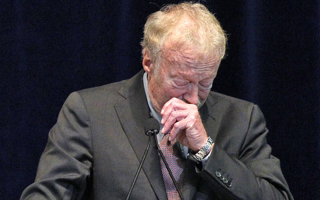 Phil Knight tries to contain his emotions while addressing the crowd at the Paterno memorial. (AP)