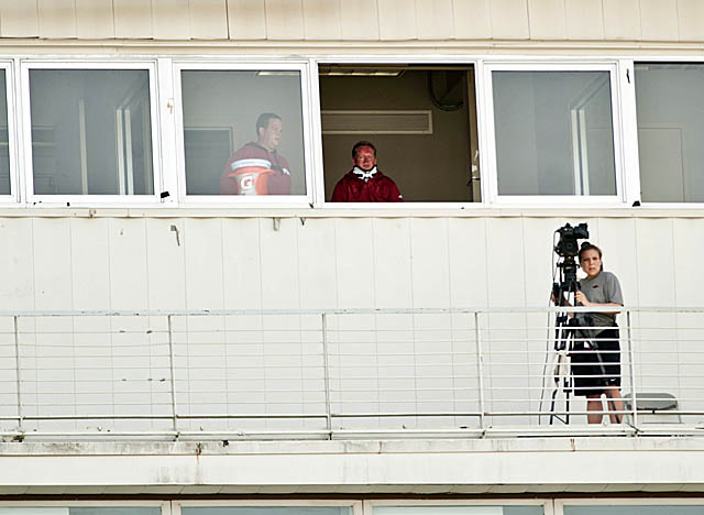 Petrino watched one of his last practices at Arkansas from the press box at Razorback Stadium. (US Presswire)