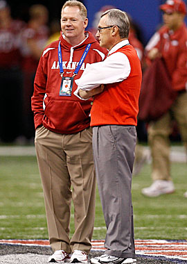 Petrino and Jim Tressel, who met in the 2011 Sugar Bowl, have in common lying to their bosses. (Getty Images)