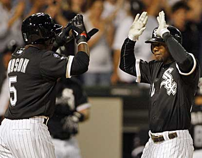 Orlando Hudson (left) and Alejandro De Aza celebrate following De Aza's grand slam in the sixth inning.  (US Presswire)