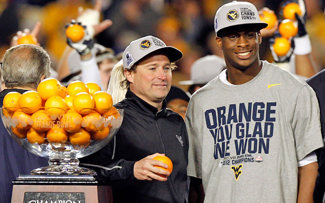 Dana Holgorsen and Geno Smith ended Year 1 together with a resounding Orange Bowl win. (Getty Images)