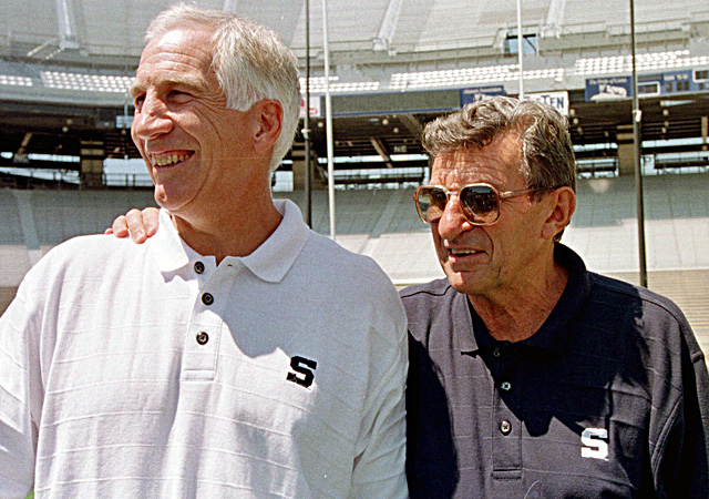 Jerry Sandusky and the late Joe Paterno share a laugh together in 1999. (AP)