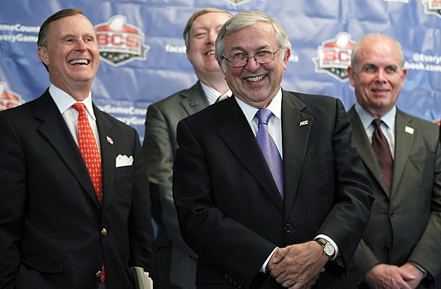 Why are these university presidents smiling? Some of them diminsh their schools' championship chances. (AP)