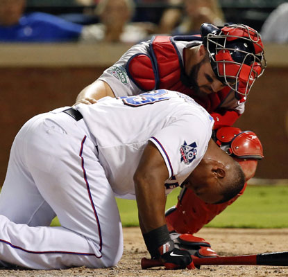 Adrian Beltre is hit in the helmet by Red Sox reliever Vicente Padilla and has to leave the game in the eighth inning.  (US Presswire)