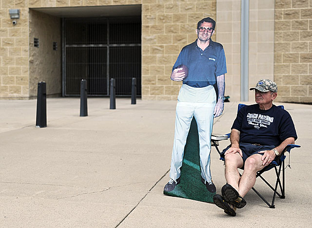 A fan sits outside Beaver Stadium after the coach's statue was removed. (Getty Images)